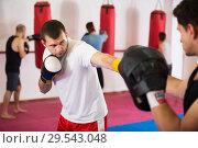 Купить «Sportsmen competing in boxing gloves», фото № 29543048, снято 5 мая 2017 г. (c) Яков Филимонов / Фотобанк Лори