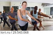 Купить «Group of multinational smiling adult people enjoying new dance techniques», фото № 29543068, снято 30 июля 2018 г. (c) Яков Филимонов / Фотобанк Лори