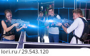 Купить «man and woman with laser weapons», фото № 29543120, снято 27 августа 2018 г. (c) Яков Филимонов / Фотобанк Лори