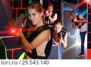 Купить «Girl holding laser pistol while playing lasertag game with frien», фото № 29543140, снято 27 августа 2018 г. (c) Яков Филимонов / Фотобанк Лори