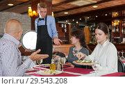 Купить «Dissatisfied guests complaining to waiter», фото № 29543208, снято 2 ноября 2018 г. (c) Яков Филимонов / Фотобанк Лори
