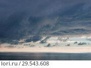 Купить «Heavy blue clouds over the sea dramatic seascape», фото № 29543608, снято 8 ноября 2017 г. (c) Константин Лабунский / Фотобанк Лори
