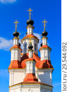 Купить «Russian white orthodox Temple of the Entry of the Lord into Jerusalem against the blue sky The Nativity Church, Totma, Russia. Architectural forms reminiscent of a ship», фото № 29544092, снято 17 июня 2019 г. (c) Mikhail Starodubov / Фотобанк Лори
