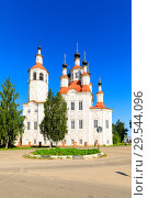 Купить «Russian white orthodox Temple of the Entry of the Lord into Jerusalem against the blue sky The Nativity Church, Totma, Russia. Architectural forms reminiscent of a ship», фото № 29544096, снято 17 июня 2019 г. (c) Mikhail Starodubov / Фотобанк Лори