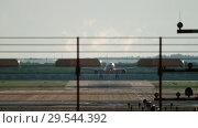 Купить «Widebody airplane approaching and landing», видеоролик № 29544392, снято 3 августа 2018 г. (c) Игорь Жоров / Фотобанк Лори