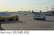 Купить «Service vehicle moves through the airport», видеоролик № 29545332, снято 1 августа 2018 г. (c) Андрей Радченко / Фотобанк Лори