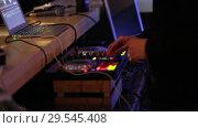 Купить «Hands on mixing console in music recording studio», видеоролик № 29545408, снято 18 июля 2019 г. (c) Евгений Ткачёв / Фотобанк Лори