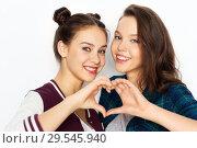 Купить «happy smiling teenage girls showing heart sing», фото № 29545940, снято 19 декабря 2015 г. (c) Syda Productions / Фотобанк Лори