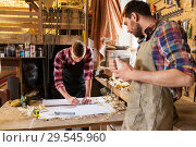 Купить «carpenters with ruler and blueprint at workshop», фото № 29545960, снято 14 мая 2016 г. (c) Syda Productions / Фотобанк Лори