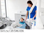 Купить «dentist making x-ray of kid teeth at dental clinic», фото № 29546036, снято 22 апреля 2018 г. (c) Syda Productions / Фотобанк Лори