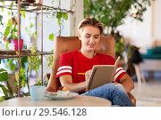 Купить «teenage girl with notebook at coffee shop or cafe», фото № 29546128, снято 7 августа 2018 г. (c) Syda Productions / Фотобанк Лори