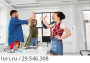 Купить «happy creative team making high five at office», фото № 29546308, снято 1 апреля 2018 г. (c) Syda Productions / Фотобанк Лори