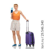 Купить «smiling teenage girl with travel bag and air ticket», фото № 29546340, снято 30 июня 2018 г. (c) Syda Productions / Фотобанк Лори