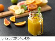 Купить «mason jar glass of fruit juice on slate table top», фото № 29546436, снято 4 апреля 2018 г. (c) Syda Productions / Фотобанк Лори