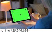 Купить «woman has video call on tablet with green screen», видеоролик № 29546624, снято 10 декабря 2018 г. (c) Syda Productions / Фотобанк Лори