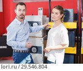 Купить «Attractive girl with boyfriend buying for new reliable safe box», фото № 29546804, снято 17 апреля 2018 г. (c) Яков Филимонов / Фотобанк Лори