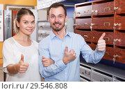 Купить «Nice girl with man looking for reliable mailbox», фото № 29546808, снято 17 апреля 2018 г. (c) Яков Филимонов / Фотобанк Лори