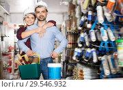 Купить «Happy female with man in helmet with instruments», фото № 29546932, снято 16 февраля 2018 г. (c) Яков Филимонов / Фотобанк Лори