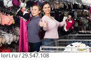 Купить «Women shopping uplifts and panties», фото № 29547108, снято 16 января 2019 г. (c) Яков Филимонов / Фотобанк Лори