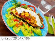 Купить «Eggplant stuffed with vegetables and baked with cheese, served at plate», фото № 29547196, снято 16 февраля 2019 г. (c) Яков Филимонов / Фотобанк Лори
