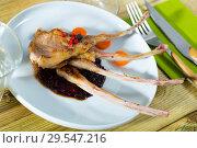 Купить «Baked lamb ribs with golden crust», фото № 29547216, снято 19 декабря 2018 г. (c) Яков Филимонов / Фотобанк Лори
