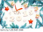 Купить «New Year 2019 background,2019 figures,Christmas toys, fir branches. Flat lay, top view-New Year 2019 festive still life», фото № 29547344, снято 30 ноября 2016 г. (c) Зезелина Марина / Фотобанк Лори