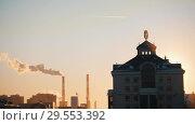 Купить «Sunset. Metro sign at the top of the building. Industry chimney on the background», фото № 29553392, снято 16 февраля 2020 г. (c) Константин Шишкин / Фотобанк Лори