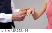 close up of man giving diamond ring to woman. Стоковое видео, видеограф Syda Productions / Фотобанк Лори