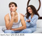 Smiling girl trying to comfort upset husband. Стоковое фото, фотограф Яков Филимонов / Фотобанк Лори