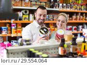 Купить «Couple discussing and selecting paint», фото № 29554064, снято 22 мая 2019 г. (c) Яков Филимонов / Фотобанк Лори