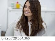 Купить «Beautiful young woman at the reception at the dentist.», фото № 29554360, снято 7 ноября 2018 г. (c) Женя Канашкин / Фотобанк Лори