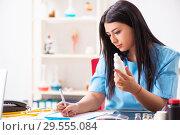 Купить «Young beautiful female doctor working in the clinic», фото № 29555084, снято 12 июля 2018 г. (c) Elnur / Фотобанк Лори