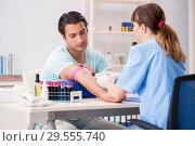 Купить «Young patient during blood test sampling procedure», фото № 29555740, снято 24 июля 2018 г. (c) Elnur / Фотобанк Лори