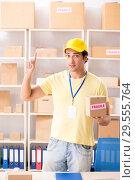 Купить «Handsome contractor working in box delivery relocation service», фото № 29555764, снято 24 июля 2018 г. (c) Elnur / Фотобанк Лори