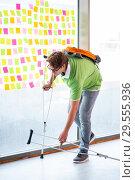 Купить «Young handsome student with crutches in conflicting priorities c», фото № 29555936, снято 25 августа 2018 г. (c) Elnur / Фотобанк Лори