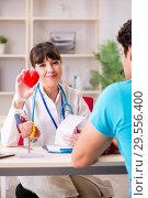 Купить «Young patient visiting doctor cardiologist», фото № 29556400, снято 2 июля 2018 г. (c) Elnur / Фотобанк Лори