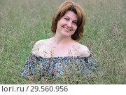 Купить «Portrait of beautiful woman in the grass on a summer day», фото № 29560956, снято 19 июня 2017 г. (c) Володина Ольга / Фотобанк Лори