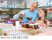 Купить «attentive father doing shopping with preteen girl in supermarket», фото № 29561332, снято 4 июля 2018 г. (c) Яков Филимонов / Фотобанк Лори