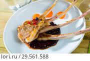 Купить «Baked under tasty lamb ribs served with sauce and carrots», фото № 29561588, снято 17 декабря 2018 г. (c) Яков Филимонов / Фотобанк Лори