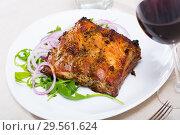 Купить «Tasty pork ribs baked under sauce, served with arugula and onion salad», фото № 29561624, снято 23 марта 2019 г. (c) Яков Филимонов / Фотобанк Лори