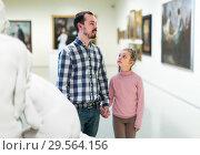 Купить «concentrated father and daughter regarding paintings in museum», фото № 29564156, снято 14 декабря 2018 г. (c) Яков Филимонов / Фотобанк Лори