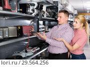 Купить «Couple buying coffee machine in household appliances store», фото № 29564256, снято 1 марта 2018 г. (c) Яков Филимонов / Фотобанк Лори