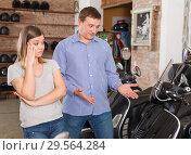 Купить «Man with woman are choosing modern motobikes and woman is surprised choice her boyfriend», фото № 29564284, снято 8 мая 2018 г. (c) Яков Филимонов / Фотобанк Лори