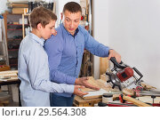 Купить «Guy and boy restoring old wooden furniture with belt sander», фото № 29564308, снято 17 мая 2017 г. (c) Яков Филимонов / Фотобанк Лори