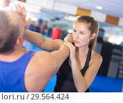 Купить «Attractive female is fighting with trainer», фото № 29564424, снято 21 августа 2017 г. (c) Яков Филимонов / Фотобанк Лори