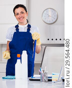 Купить «Cheerful female cleaning furniture in office», фото № 29564480, снято 2 июня 2017 г. (c) Яков Филимонов / Фотобанк Лори