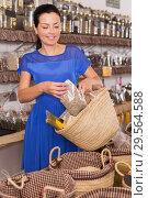Купить «Woman choosing herbs and spices», фото № 29564588, снято 13 июня 2017 г. (c) Яков Филимонов / Фотобанк Лори