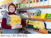 Купить «woman customer with packaging of pasta», фото № 29564632, снято 15 декабря 2017 г. (c) Яков Филимонов / Фотобанк Лори