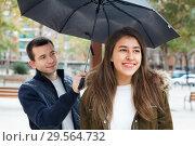 Купить «Young charming couple having a city walk», фото № 29564732, снято 22 марта 2019 г. (c) Яков Филимонов / Фотобанк Лори