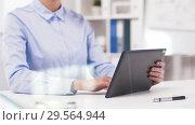 Купить «businesswoman with tablet computer works at office», видеоролик № 29564944, снято 10 декабря 2018 г. (c) Syda Productions / Фотобанк Лори
